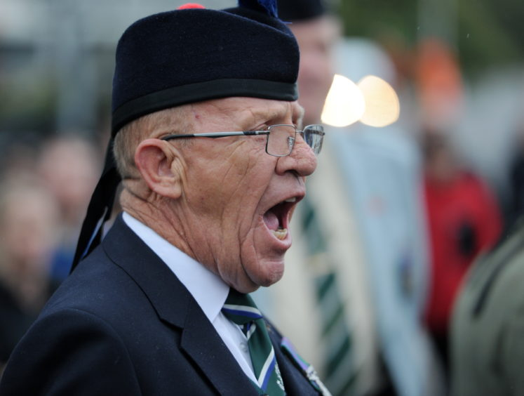 Warrant Officer 2 Albert Duffus of Forres barks out the orders to the parade. Picture by Sandy McCook
