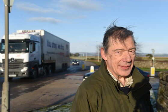 Campaigner Michael Baird at the northern junction from the A9 to Tain, where a roundabout could be introduced. Picture by Sandy McCook
