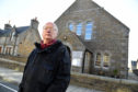 CLLR GLEN REYNOLDS AT MARNOCH CHURCH HALL IN ABERCHIRDER.