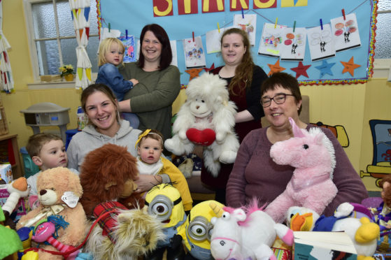 Pictured at the Toy Bank launch at the Banff Harvest Centre last year are, from the left, Naomi Earsman with children Cooper and Piper, Jillian McBain with Emmy, Katie Laing and Marion Martin, Harvest Centre administrator
