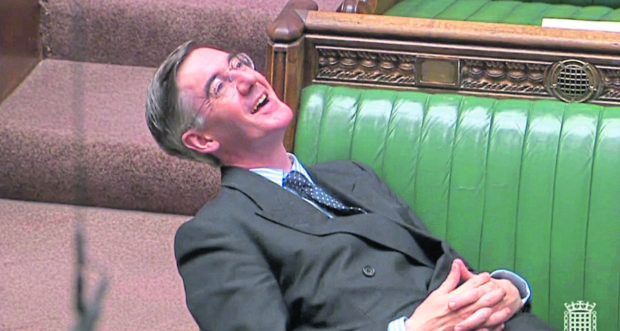 Leader of the House of Commons Jacob Rees-Mogg reclining on his seat in the House of Commons. Picture by  PA Wire