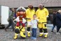 Members of the Peterhead RNLI team and mascot Stormy Stan met attendees
