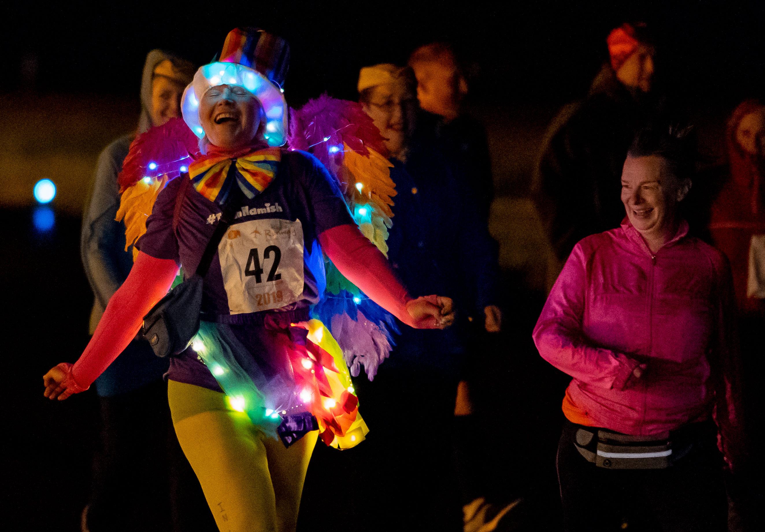 Amanda Galletch illuminates all around her at Run the Runway event.