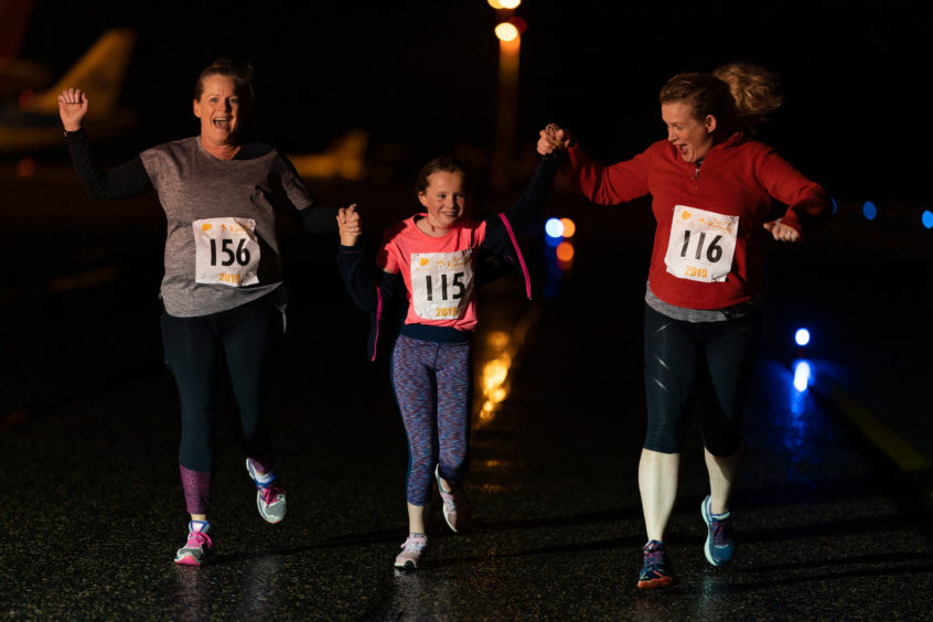 Delighted to cross the line, L-R - Beth O'Rorke, Sophie Mathieson and mum, Roz Mathieson