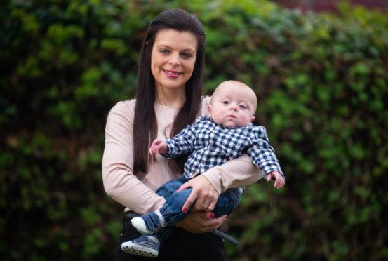 Proud mum Sarah Lawson with son Harry Smart.