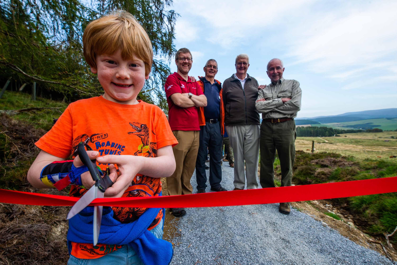 From left: Henry Moir 7, Grant Moir (CNPA),  Tony Birchall from Glenlivet Walking Group,  Brian Fowler from Glenlivet Walking Group, Steve Smith (TGLP).