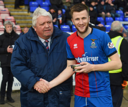 Outgoing Caley Thistle chairman Graham Rae, with former midfielder Liam Polworth.