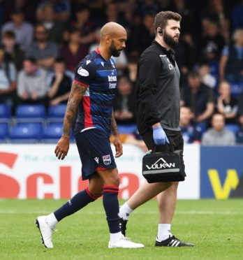 24/08/19 LADBROKES PREMIERSHIP ROSS COUNTY vs LIVINGSTON (1-4) GLOBAL ENERGY STADIUM - DINGWALL Ross County's Liam Fontaine suffers an injury