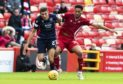 Ross County striker Ross Stewart in action against Aberdeen.