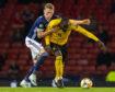 Scotland's Scott McTominay (left) battles with former Manchester United team-mate Romelu Lukaku