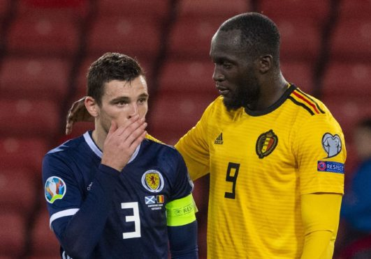 Scotland's Andy Robertson is consoled by Romelu Lukaku at full time