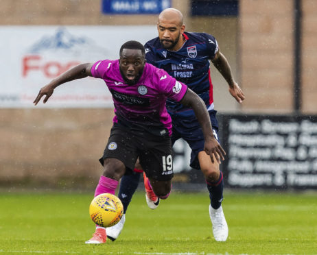 Ross County's Liam Fontaine (right)