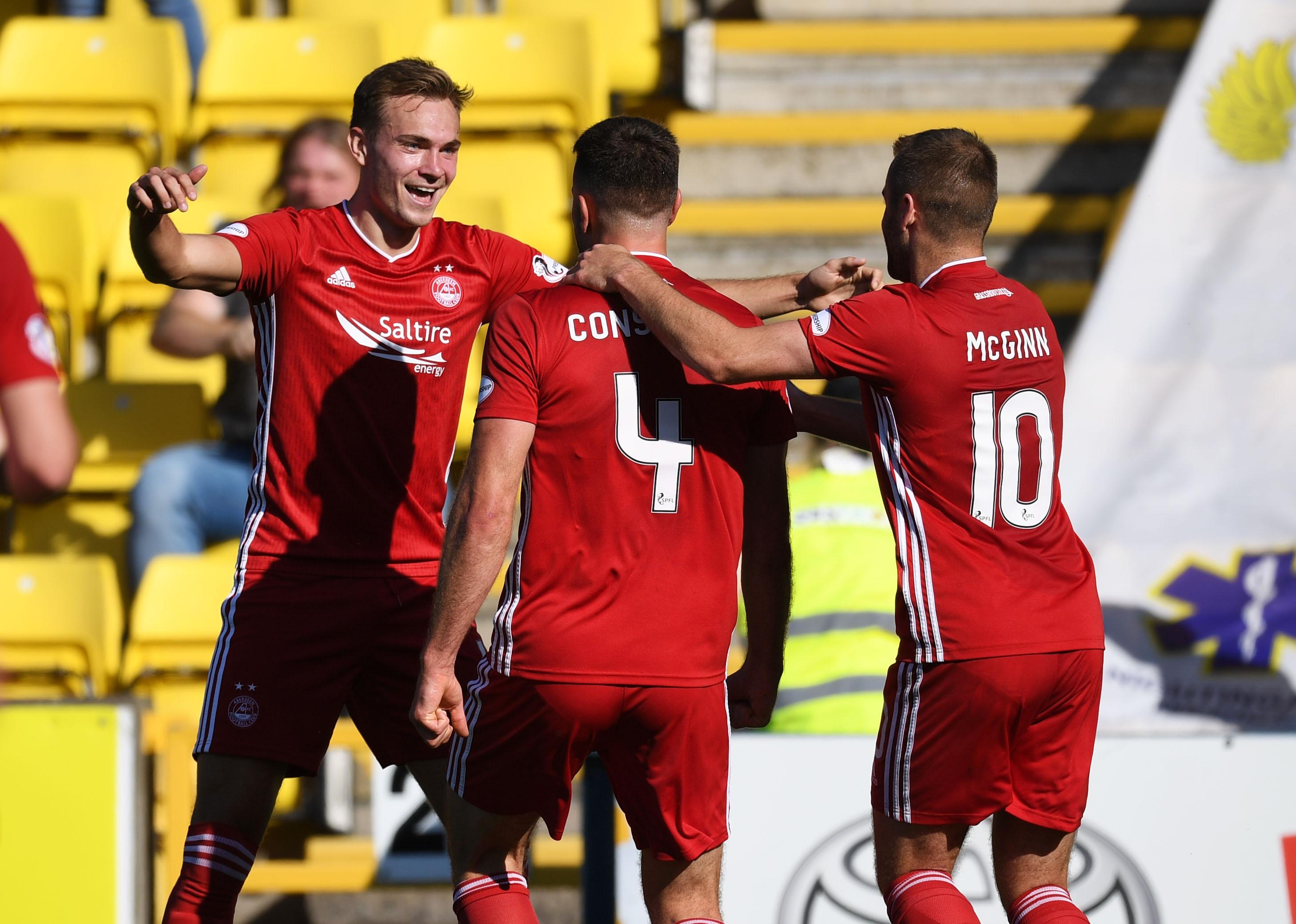 Aberdeen's Andrew Considine (centre) celebrates his goal at Livingston