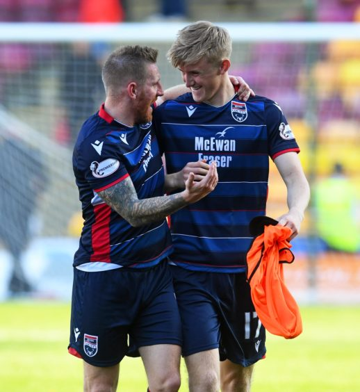 Ross County's Michael Gardyne (L) celebrates at full time with teammate Ewan Henderson during the Ladbrokes Premiership match between Motherwell and Ross County at Fir Park on September 21, 2019, in Motherwell, Scotland