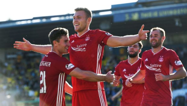 Aberdeen's Sam Cosgrove (centre) celebrates his goal during the Ladbrokes Premiership match between Livingston and Aberdeen