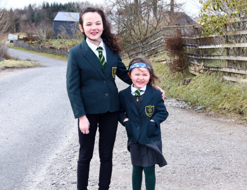 Sophie and  Lucy MacGregor at Ardconnel farm where the bus provide by argyll and bute council used to pic up their children pic kevin mcglynn