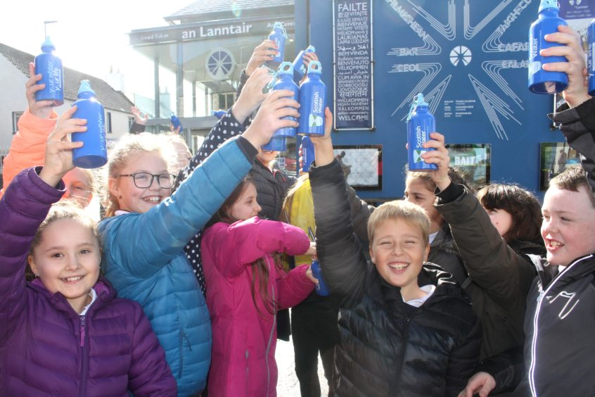 P6 and P7 pupils from Back Primary School say cheers to Scottish Water's new Top Up Tap outside the An Lanntair Arts Centre in Stornoway