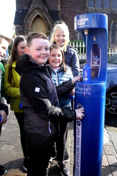 P6 pupil Aaron Davis (9) from Back Primary School is the first to fill his refillable bottle from the new Top Up Tap