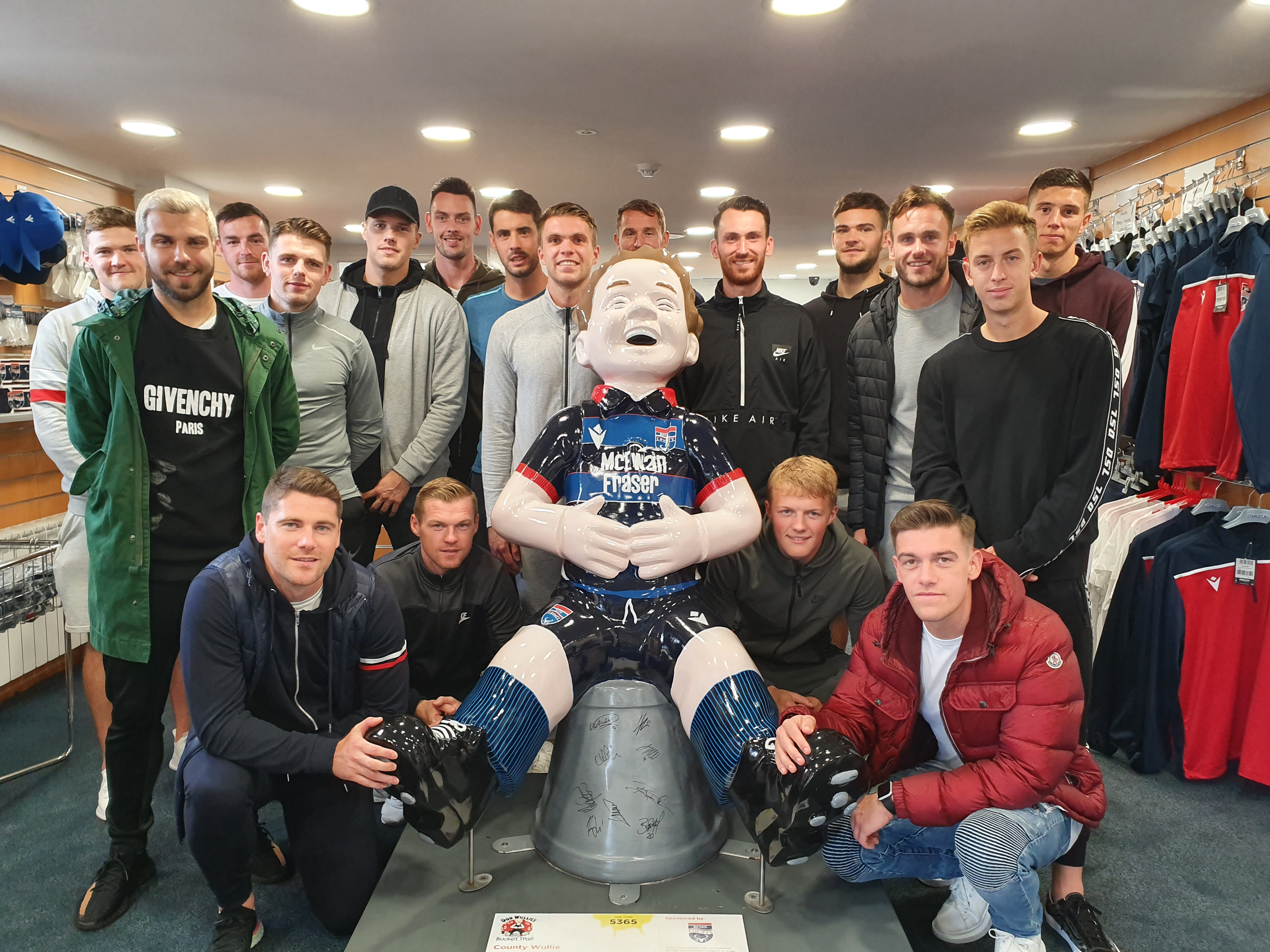 The Ross County first-team squad with Wullie after scribbling on his big bucket