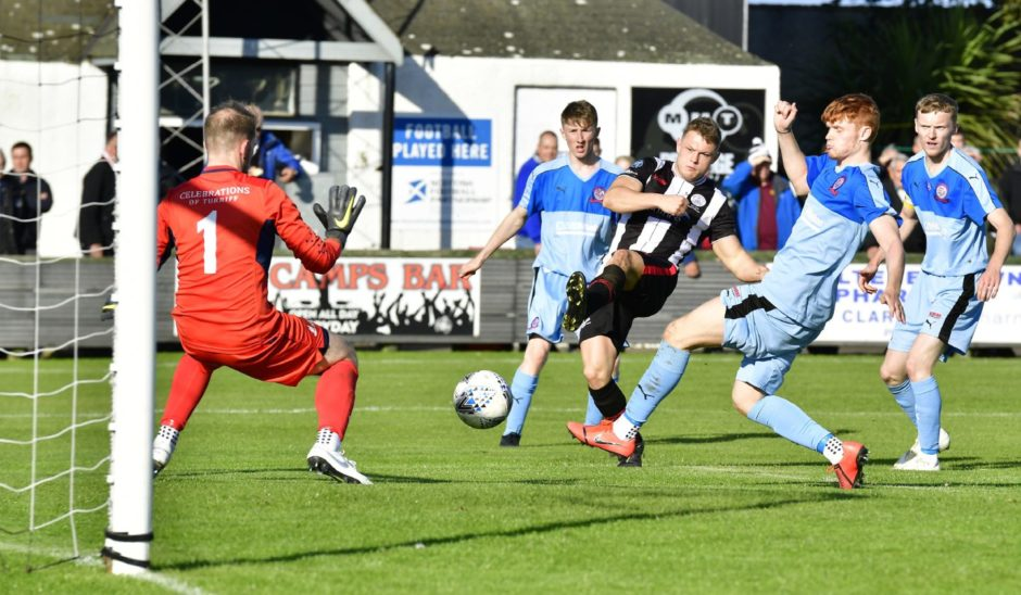 Wick's Jack Halliday fires ball past Turriff keeper Fraser Hobday