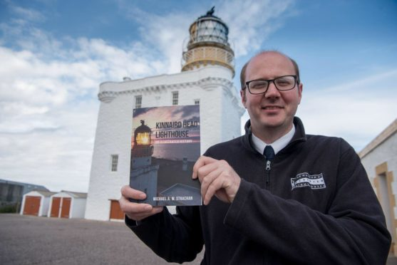 Micheal Strachan with his book ahead of the launch this Sunday - picture by Billy Watson