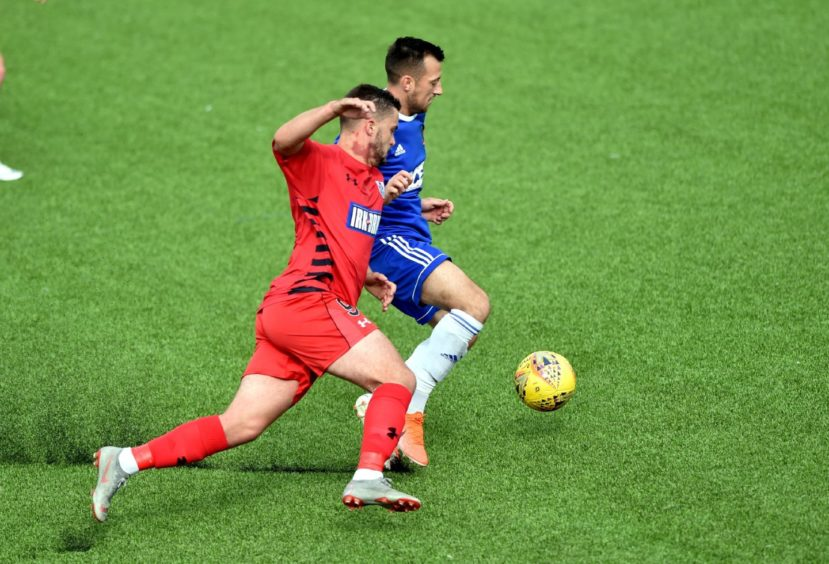 Cove's Connor Scully and Queens Park Salim Kouider-Aissa. Picture by Colin Rennie