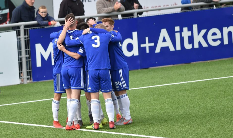 Players celebrate Cove's second goal scored by Matthew Smith. Picture by COLIN RENNIE