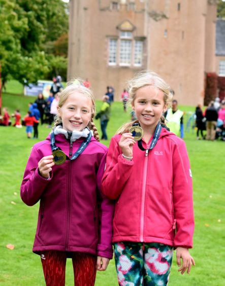 The  female winners of the kids 1.5km race.  Picture by Jim Irvine