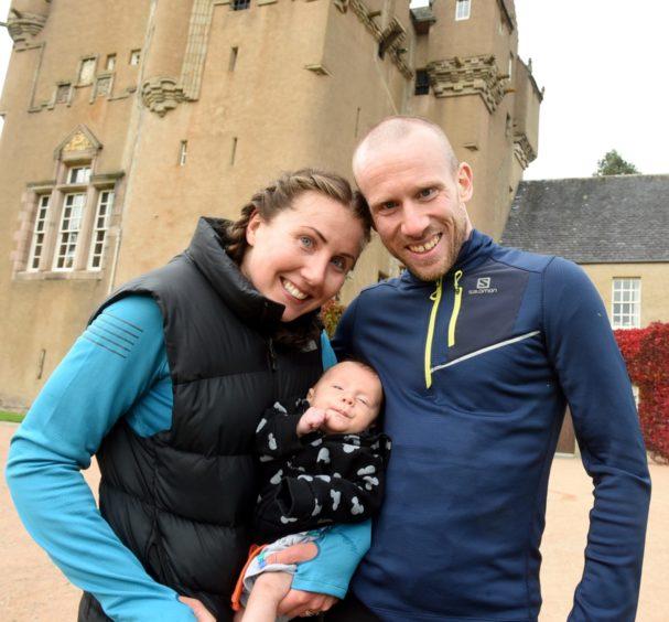 A Greig family affair with mum, Debbie half marathon second female, dad Kyle Greig, 5k winner and 10-week old Logan.  Picture by Jim Irvine