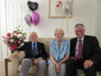 Chrissie (aged 92) and Charlie Murray (aged 94) of Banff with Andrew Simpson (Lord Lieutenant of Banffshire).