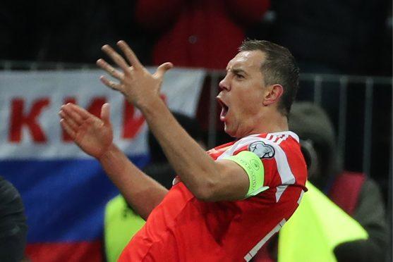 Artem Dzyuba struck twice on a memorable night for Russia.