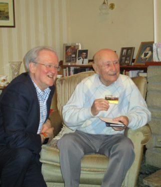 Stewart Stevenson MSP with Bob Ritchie holding his SNP Life Membership card