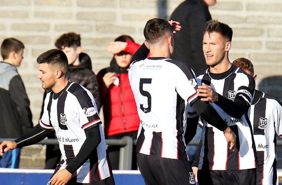 Brian Cameron no8 celebrating his goal which put Elgin 1 nil up, with team-mates.