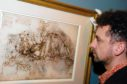An exhibition of 10 of Leonardo Da Vinci's finest drawings on loan from the Royal Collection in 2006 at Aberdeen Art Gallery.  Martin Clayton, deputy curator of the print room at Windsor Castle, is seen looking at one of the drawings.  Taken by Raymond Besant.