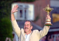 Europe's team captain Sam Torrance holds up the Ryder Cup after the presentation at the Belfry, near Sutton Coldfield following his team's defeat of the USA.