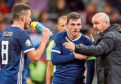 Scotland manager Steve Clarke speaks to John McGinn and Andrew Robertson (centre) during the UEFA Euro 2020 qualifying, group I match at the Luzhniki Stadium, Moscow.
