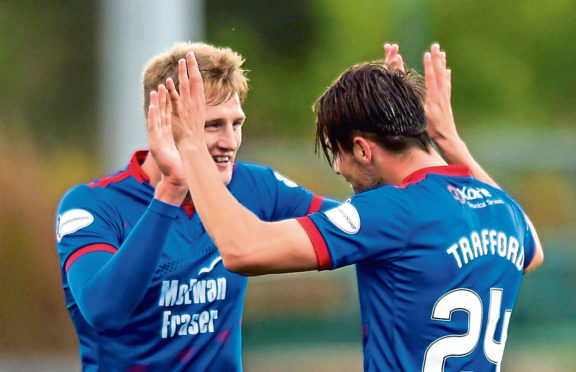 Charlie Trafford (R) celebrates his goal to make it 2-0 with Coll Donaldson