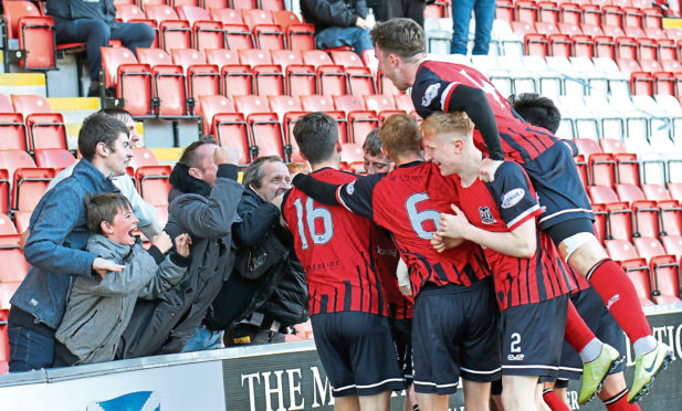 Kane Hester is congratulated by supporters and team-mates.