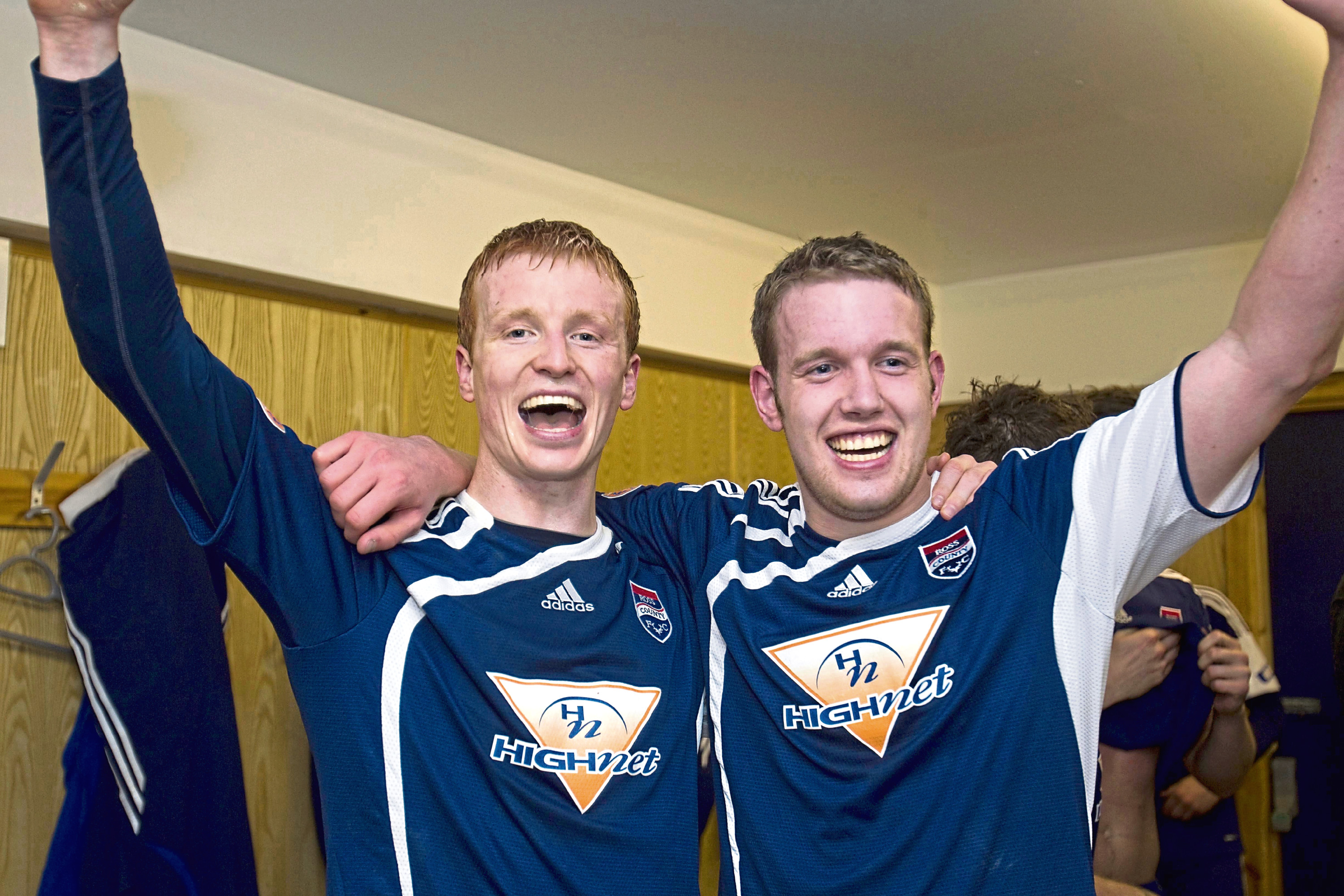 Ross County's Scott Boyd and Garry Wood celebrate in the dressing room following victory over Hibernian in the Scottish Cup Sixth Round Replay in 2010