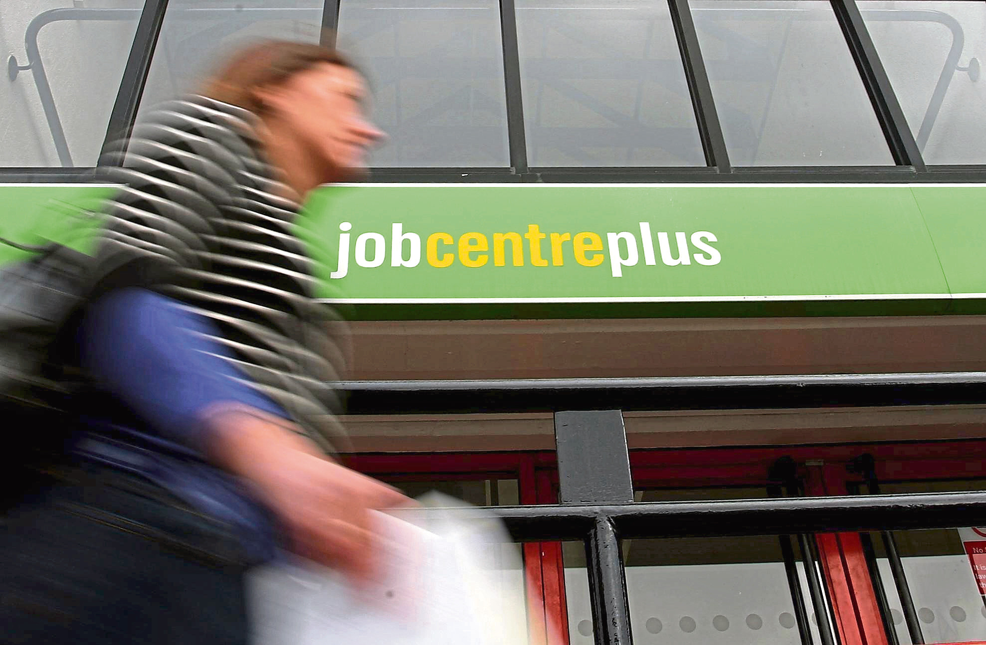 File photo dated 18/03/09 of a general view of a Job Centre in Manchester. The number of young people unemployed for more than a year has increased almost nine-fold over the past decade, according to a new study.
