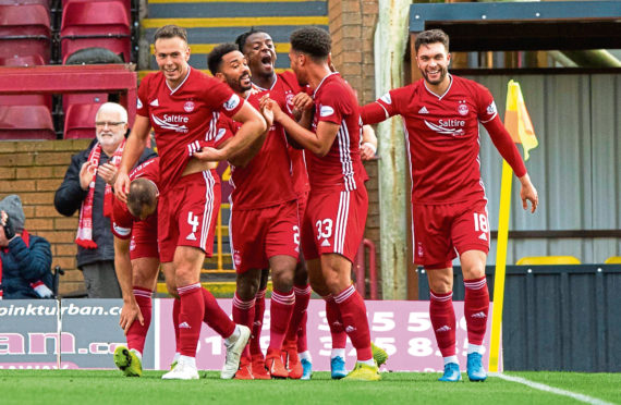 Zak Vyner celebrates his goal with his team mates.