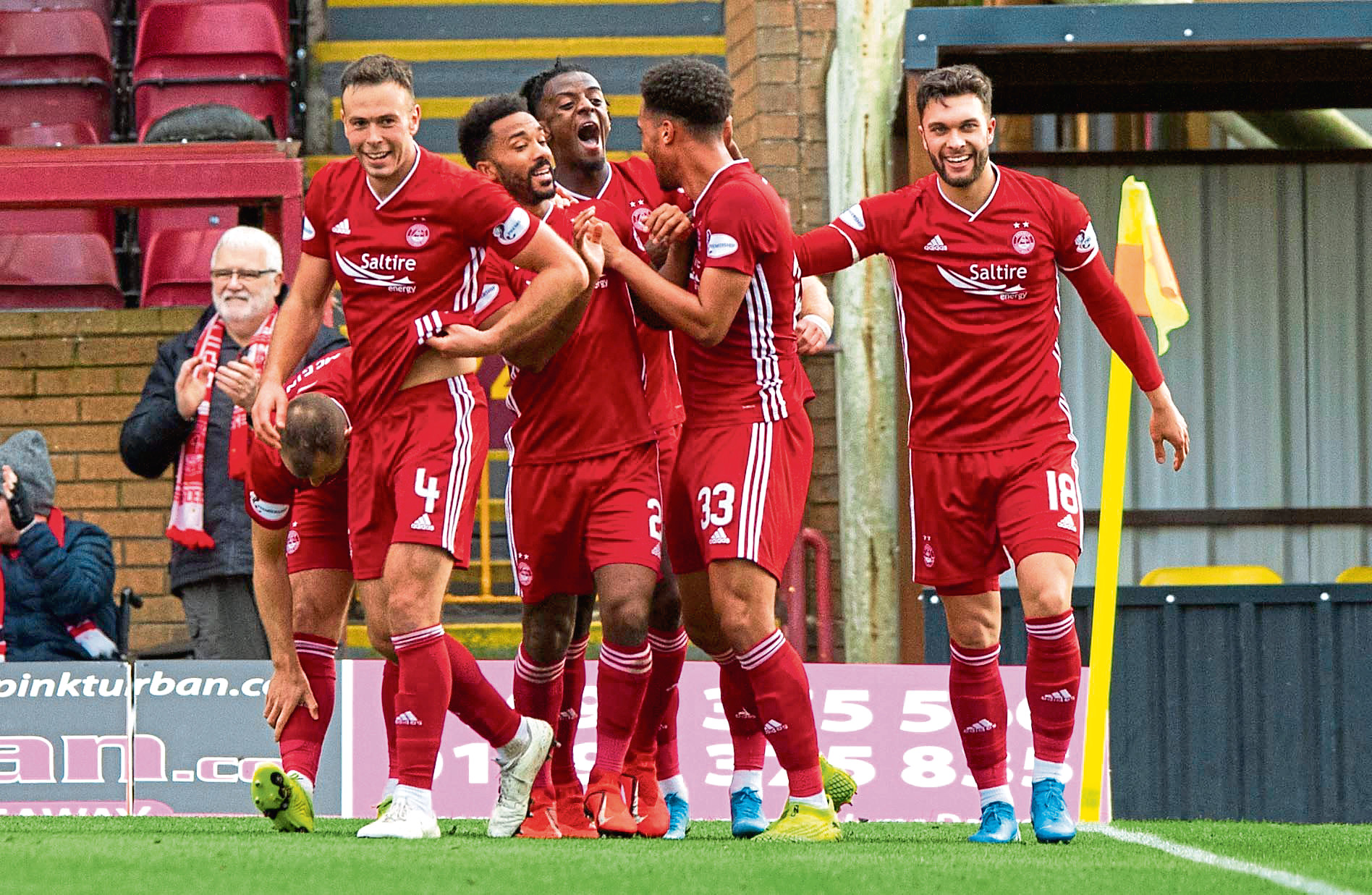 Zak Vyner celebrates his goal with his team mates.