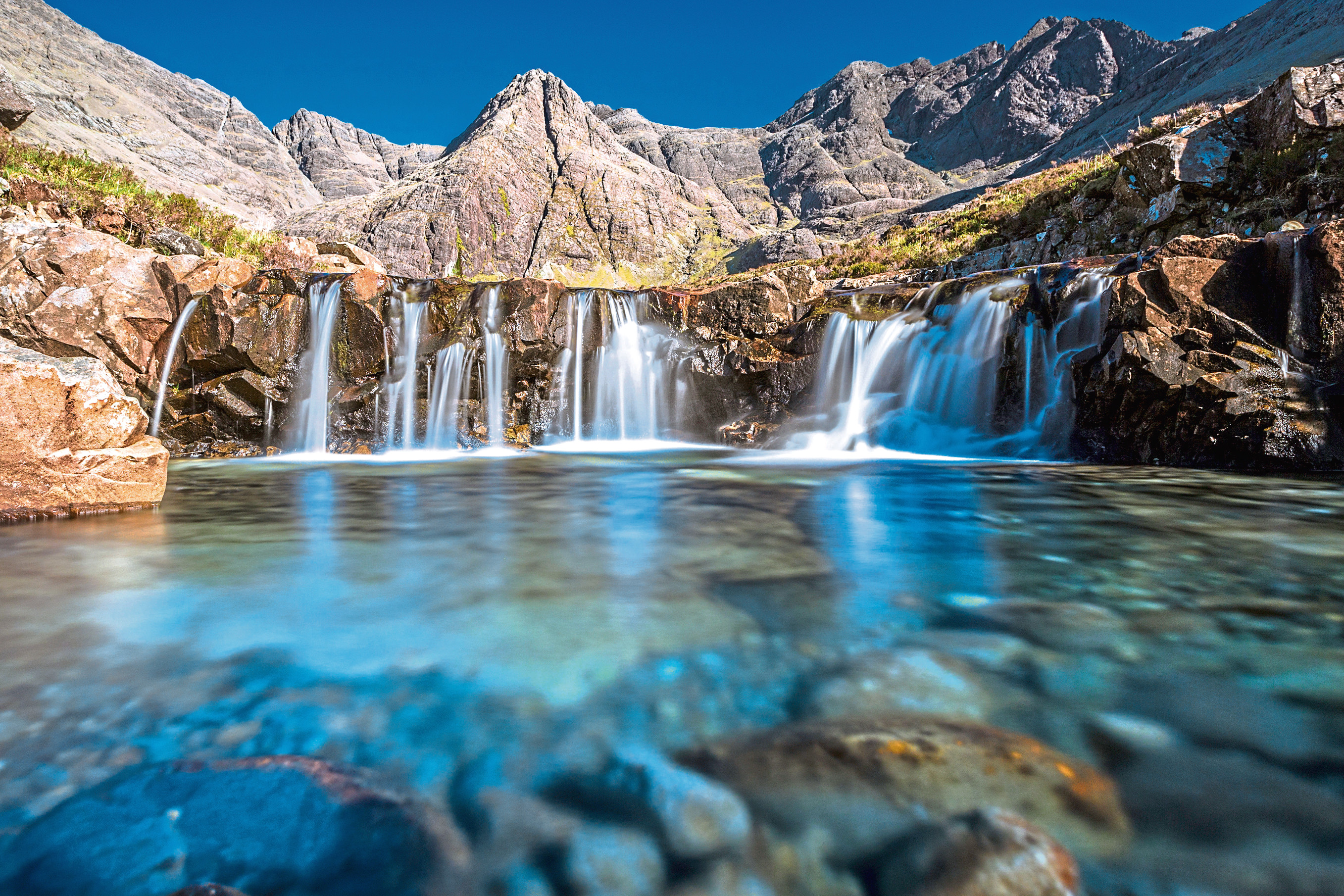 fav Turquoise pools, also called Fairy Pools,  in Isle of Skye, Scotland.
