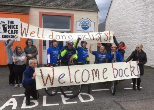 Fundraising cyclists are welcomed back by users of Kyleakin Connections
