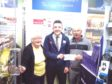 Lesley Glasser and Alistair Henderson receiving the Scotmid cheque.