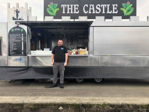 Ashley Forbes outside his food van.