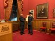Group Captain Phil Dacre awarding Cadet Warrant Officer Jamal Ronald with the commemorative certificate