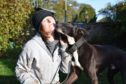Karen Fairclough with  Peter the pointer/lurcher who has to be kept on a lead until the repairs are made