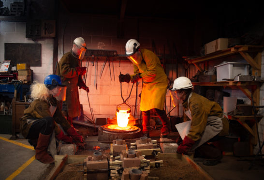 Pictures by JASON HEDGES With the approach of Scottish Sculpture Workshop's 40th anniversary in Lumsden, artists fill moulds with molten bronze