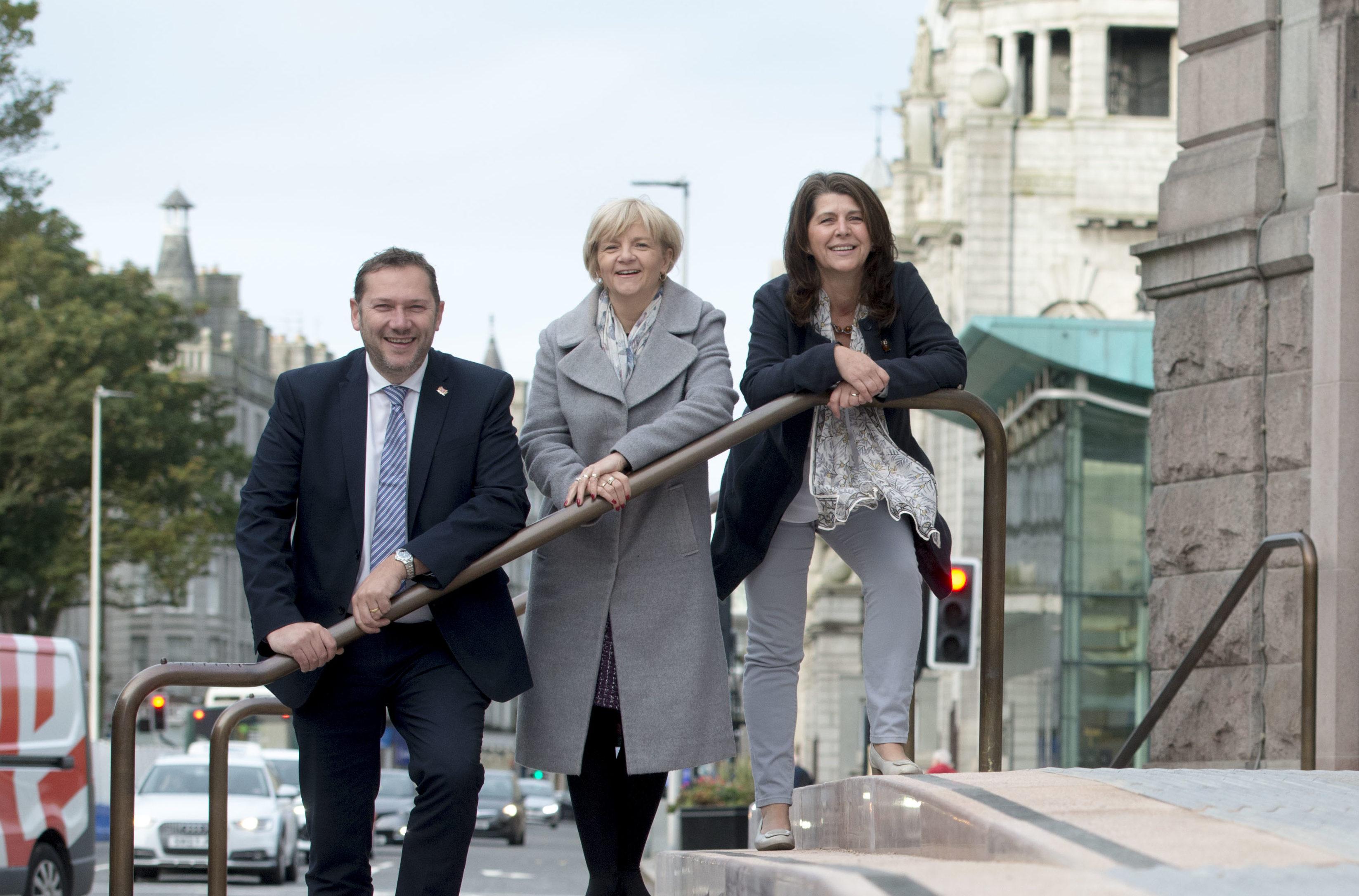 Councillor Jenny Laing, Councillor Douglas Lumsden, Councillor Marie Boulton outside the Aberdeen Art Gallery.